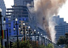 New Orleans implodes damaged cranes on partially collapsed Hard Rock hotel