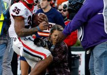 Photographer hospitalized after taking brutal hit during Georgia-Auburn game