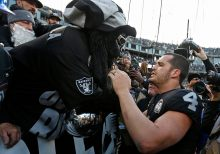 Raiders leave Oakland for final time to chorus of boos, trash in chaotic loss