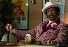 Bill Cosby's publicist calls Eddie Murphy a 'Hollywood Slave' after 'SNL' jab