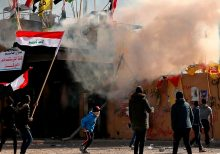 Protesters outside US Embassy in Baghdad met by tear gas from American troops guarding compound