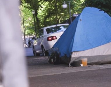 Homeless woman in Portland sleeping in front of garage run over by driver, dies at hospital, police say