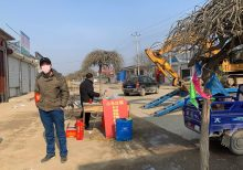 As coronavirus spreads, Beijing suburbs close themselves off