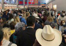 US airports swamped as coronavirus screening stalls returns from Europe