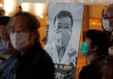 China exonerates doctor reprimanded for warning of virus