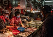 What are the 'wet markets' linked to the coronavirus outbreak?
