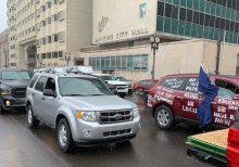 Drivers swarm Michigan capital to protest coronavirus lockdown measures