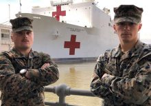 Marines race down NYC pier carrying oxygen tanks to help save patients outside USNS Comfort