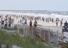Crowds flock to Jacksonville beaches; model significantly lowers Florida's expected coronavirus death toll