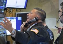 Stocks slide as oil prices crash to lowest level since 1986