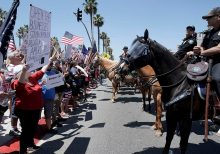 Huntington Beach protesters assail California Gov. Newsom's order closing beaches