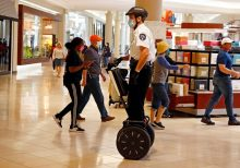 Oklahoma mall opens with shoppers in face masks and social distancing