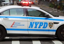 NYPD cop placed in headlock as cheering crowd looks on, video shows