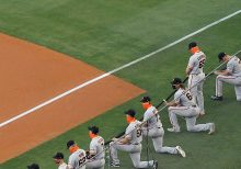 Giants' pitcher Sam Coonrod refuses to kneel during Black Lives Matter moment because of faith: 'I'm a Chri...